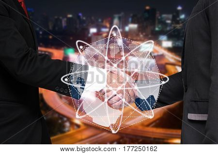 Double exposure of businessman handshake with world global media, network connection and business concept, successful business meeting on blurred night city background, color tone effect.
