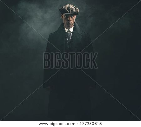 Threatening Retro 1920S English Gangster In Smoky Room.