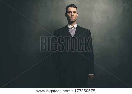 Retro 1920S English Gangster In Suit Standing With Cigarette.