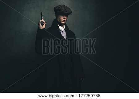 Dangerous Retro 1920S English Gangster Standing With Gun.