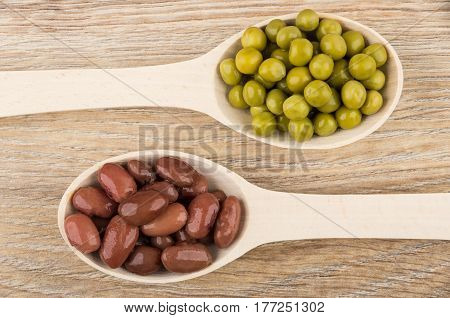Wooden Spoons With Red Baked Beans And Green Peas