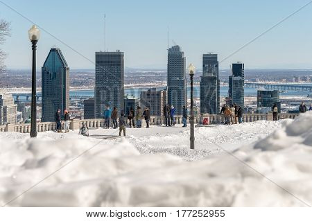 Montreal Canada - 17 March 2017: Many tourists are standing on Kondiaronk Belvedere to enjoy Montreal skyline.