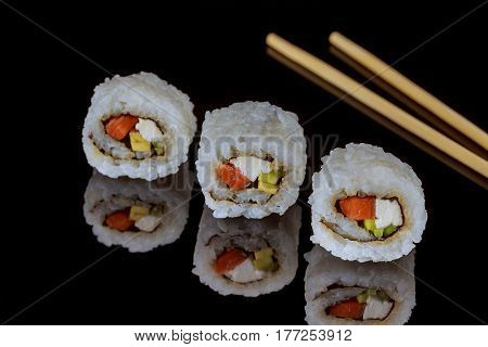 Close Up Of Sashimi Sushi Set With Chopsticks And Soy - Sushi Roll With Salmon