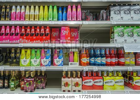 BANGKOK, THAILAND - FEBRUARY 10, 2017 : Shelves with bottles low alcohol drinks selling of Spy, Breezer in Tesco lotus supermarket. Tesco is the world's second largest retaile