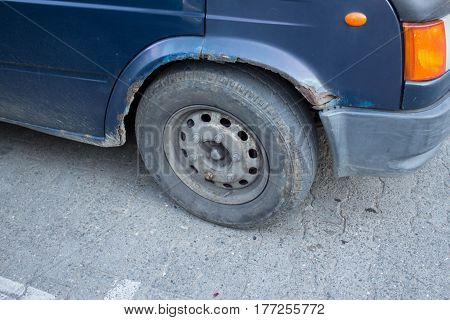 Rusty car's wheel and bod. Severe Rust and corrosion