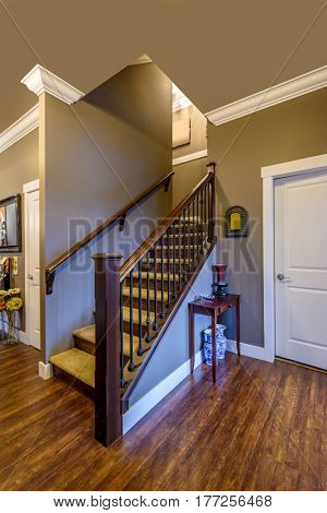 Beautiful living room interior with hardwood floors in new luxury home. View of stairs, and second story area.