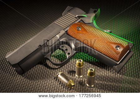 Semi auto pistol with ammunition and green backlighting