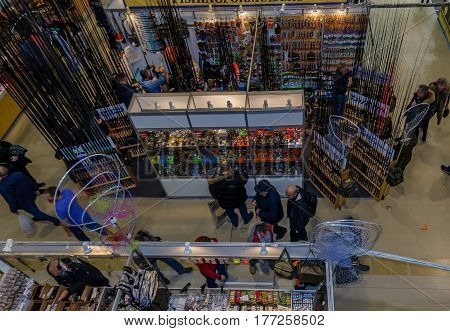 Moscow, Russia - February 25, 2017: Panoramic top view of the exhibition pavilion Hunting and fishing in Russia, VDNKh. Exhibits, participants and visitors of the fair.