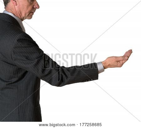 Senior caucasian businessman or executive isolated against white background. Subject is in profile and holding his hand out for money