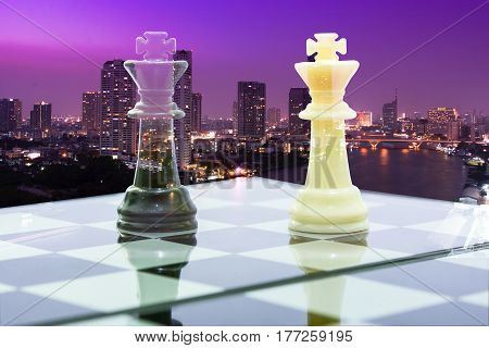 leadership black king and white king on board chess black cityscape concept business