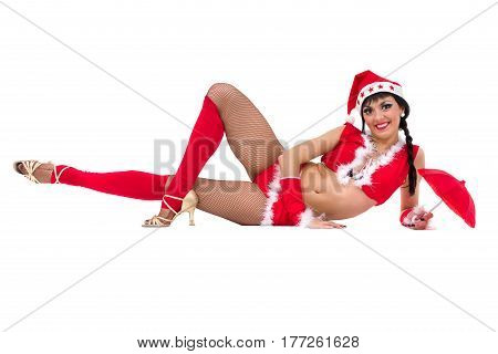 Young dancer woman in christmas hat posing in the studio. Professional ballet dancer, isolated on white background in full length.