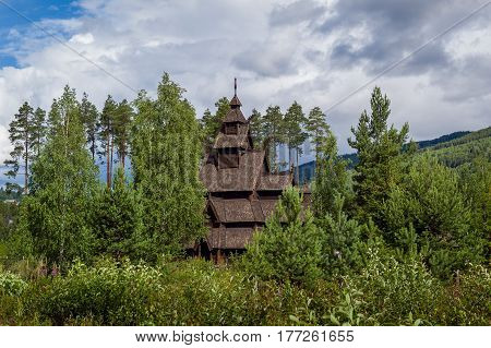 Old wooden stave church - stavkirke in Norway. Historical landmarks of Scandinavia