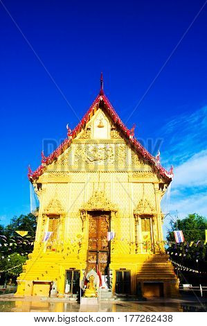 Golden temple landmark of Wat Pra Sri Arn against blue sky in Photharam Ratchaburi Province Thailand