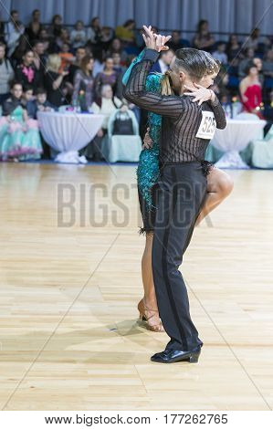 Minsk Belarus-February 19 2017: Professional Dance Couple of Trach Stanislav and Odobescu Anastasia Performs Adults Latin-American Program on WDSF Minsk Open Dance Festival-2017 on February 19 2017 in Minsk Belarus.