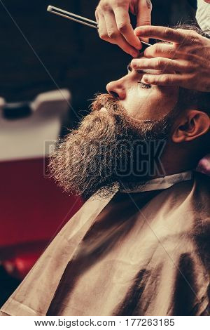 Bearded Man With Long Beard Getting Hair Shaving With Razor