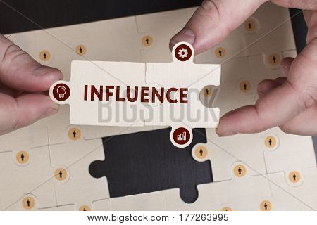 Business, Technology, Internet And Network Concept. Young Businessman Shows The Word: Influence