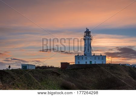 Sunset at Flamborough Head Lighthouse - Flamborough Head is an eight mile long promontory on the Yorkshire coastline. It is a chalk headland with sheer white cliffs