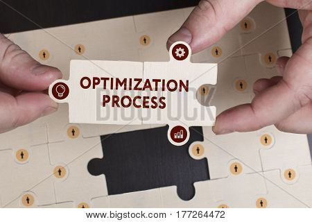 Business, Technology, Internet And Network Concept. Young Businessman Shows The Word: Optimization P