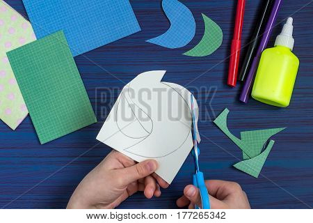 Making a greeting card for Mother's Day. Children's art project. DIY concept. Step-by-step photo instruction. Step 3. Cutting out image details