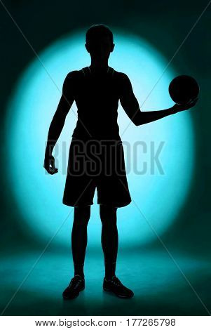 Silhouette of the basketball player