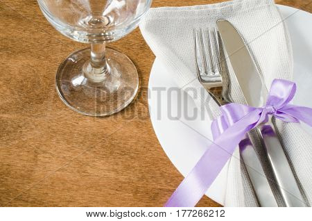 Spring Festive Table Setting With Plate Napkin and Cutlery on Wooden Table. Holidays background. Selective Focus.