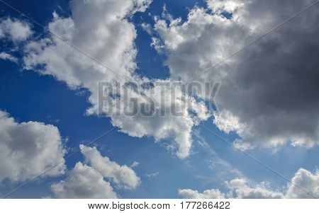 Blue sky background with white clouds. Texture of white clouds on blue sky.