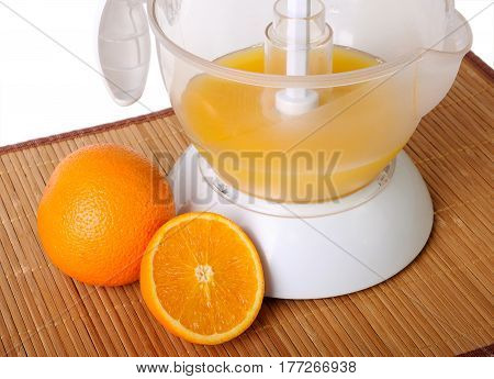 Still life with a juice extractor on mat