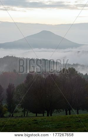 Early evening landscape with fog in Czech Switzerland