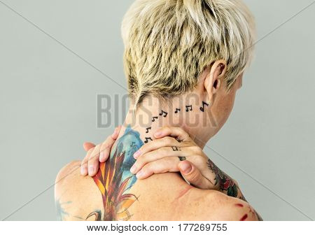 Woman shirtless with tattoo body paint