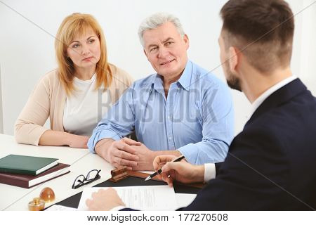 Senior couple at notary public office