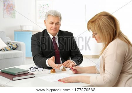 Mature woman at notary public office