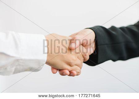 Business partnership meeting. Picture businessmans handshake. Successful businessmen handshaking after good deal. Horizontal blurred background