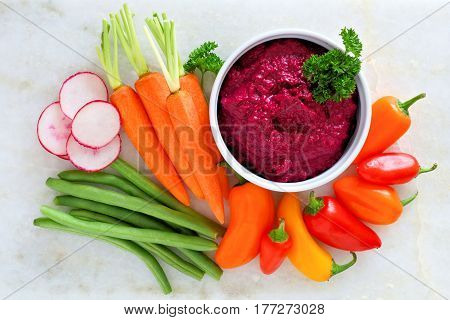 Beet Hummus Dip With A Variety Of Fresh Vegetables, Above View On A White Marble Background