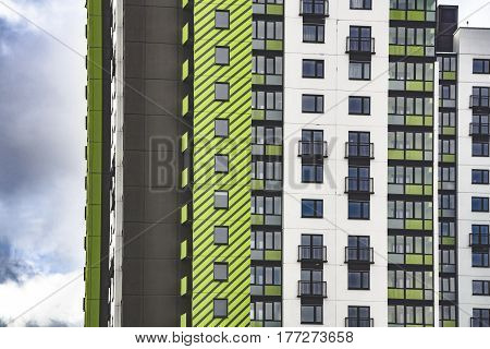 Residential creative houses of the neighborhood. Multi-storey building with windows background. Toned