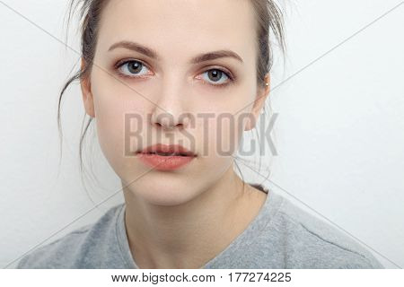 Indoor Close Up Portrait Of Charming Young Lady Of European Appearance Wearing Grey Sweatshirt, Posi