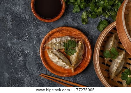 Fresh Dumplings On A Dark Stone Background.