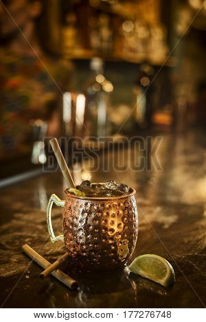 spicy rum cinnamon lime tropical cocktail drink in bar