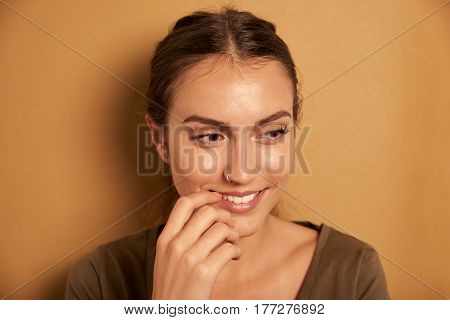 Secretive Young Woman Posing For Camera