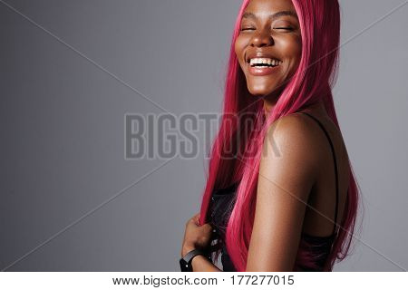 happy laughing black woman wears pink wig