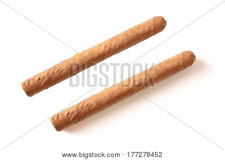 The same cuban cigar closeup with shadow and isolated over white background