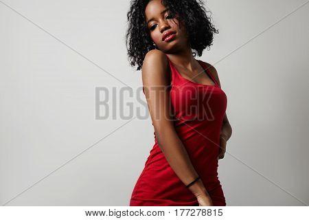 black woman in red dress showing beauty body