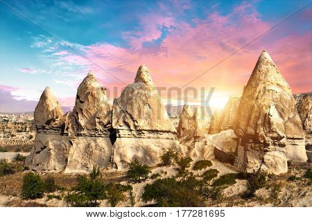 Rocks looking like teeth dramatically lit by a sunset in Cappadocia, Turkey