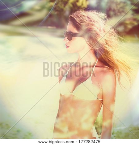 girl in bikini and sunglasses portrait outdoor by the river summer time