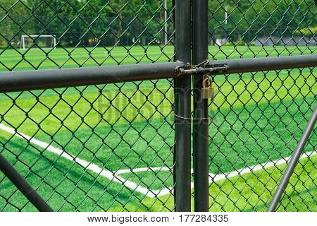 soccer field being locked with padlock horizontal