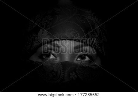 Portrait of a young muslim womanthe girl in the veilblack whiteclosed facegaze is directed towards