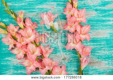 Wineglass With Light Pink Gladiolus On The Azure Background