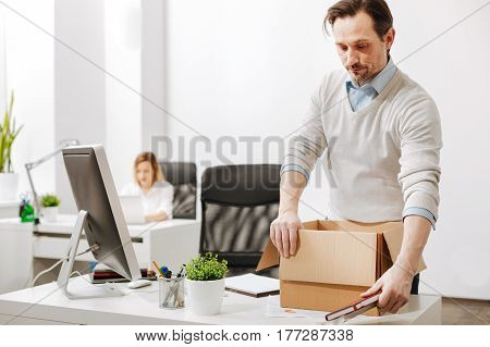 Sudden layoff. Fired involved upset employee standing and gathering the box with his personal stuff while leaving the office and expressing despair