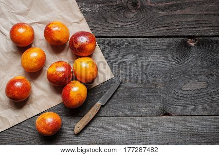 Wooden Background With Red Sicilian Oranges And Knife
