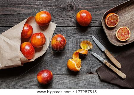 Red Oranges On The Wooden Table