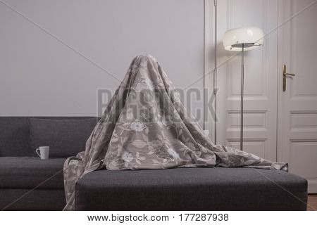 One Young Man, Hiding Beneath Sofa Bed Sheets